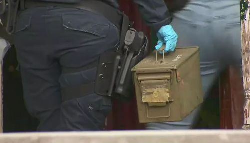 Police seized several items from the home including what appeared to be a bag of shotgun cartridges.