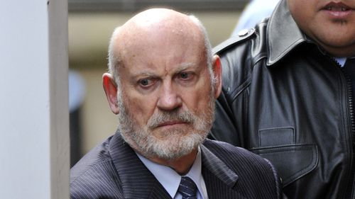 Former NSW State Labor Minister Ian MacDonald is lead to a prison van at the Supreme Court in Sydney, Friday, June 2, 2017.