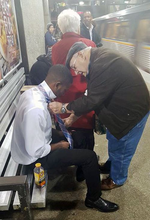 Viral photo shows elderly man teaching stranger how to tie a tie