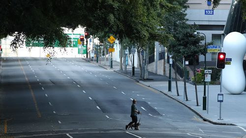 BRISBANE, AUSTRALIA - JULY 31: People are seen walking near the Brisbane CBD after lockdown on July 31, 2021 in Brisbane, Australia. Eleven local government areas in south-east Queensland will enter into a three-day lockdown from 4pm today as six new locally transmitted cases of the Covid-19 delta variant were reported.  (Photo by Jono Searle/Getty Images)