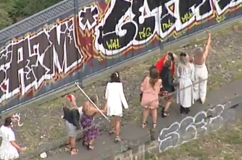 Some frustrated racegoers hopped off the stranded train. (9NEWS)