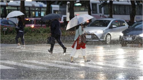 More than 200,000 people have been evacuated on an island in Japan's south as life-threatening levels of record rainfall hits. (Fukuoka)
