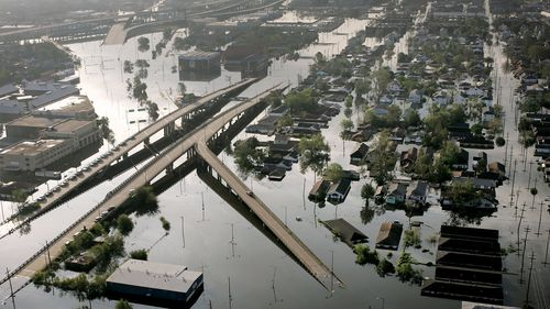 FILE - In this Aug. 30, 2005 file photo, Floodwaters from Hurricane Katrina fill the streets near downtown New Orleans. Hurricane Ida looks an awful lot like Hurricane Katrina, bearing down on the same part of Louisiana on the same calendar date. But hurricane experts say there are differences in the two storms 16 years apart that may prove key and may make Ida nastier in some ways but less dangerous in others.(AP Photo/David J. Phillip, File)