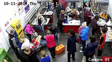 Customers continued shopping as the woman gave birth to a boy.