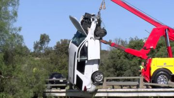 A crane was used to pull the car from the creek.