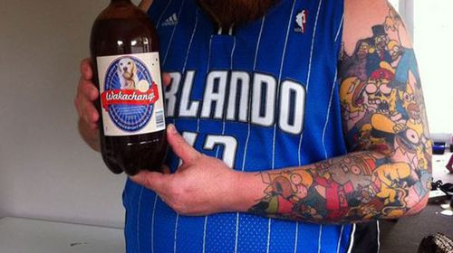 Man breaks world record with Homer tattoos