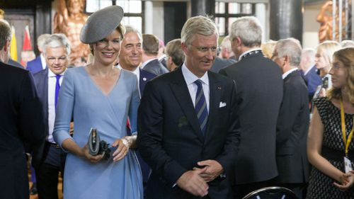 Belgian royals Queen Mathilde and King Phillipe arrive at the ceremony. (AAP)