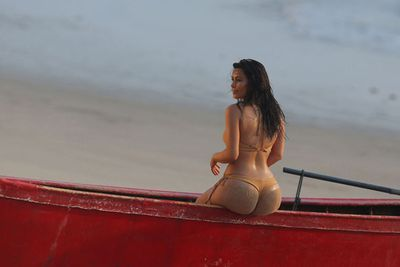 As if Thailand wasn't hot enough, Kim K bared her famous behind for a beach shoot earlier this year.<br/><br/>Image: Splash News