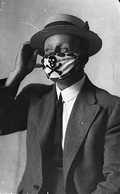 Man wears skull and cross bones surgical mask