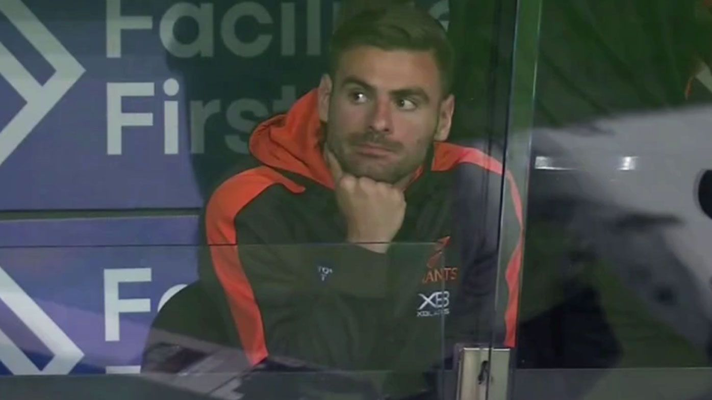 Stephen Coniglio sits on the sidelines after he was dropped for GWS' clash against the Demons.