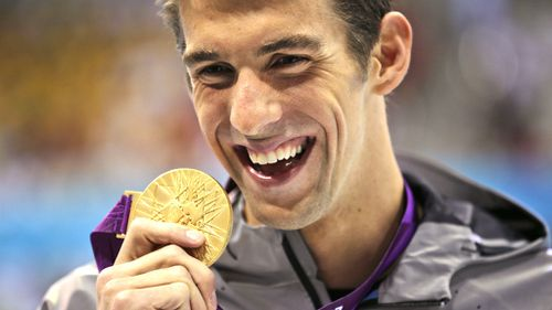 Michael Phelps, pictured with a gold medal at the London Olympics, is the most decorated Olympian in history. (AAP)