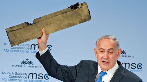 Israel PM Benjamin Netanyahu holds up what he said was part of a downed Iranian drone. (AP).