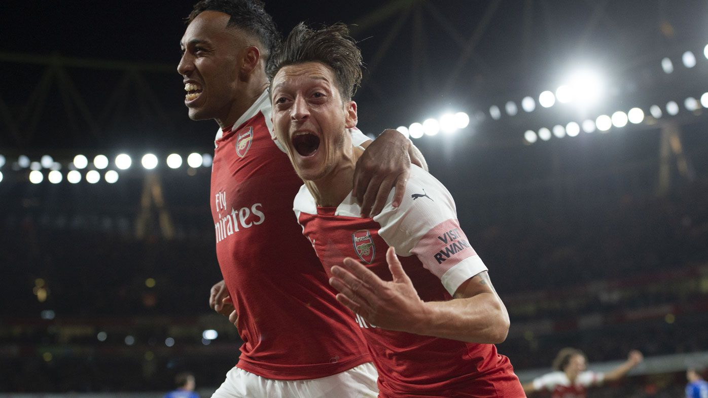 Pierre-Emerick Aubameyang and Mesut Ozil celebrate.