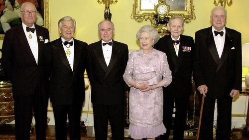 Queen Elizabeth with present and former Australian Prime Ministers, left to right, Malcolm Fraser, Bob Hawke, the present PM John Howard, John Gorton and Gough Whitham, before a dinner at Buckingham Palace in 2000.