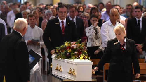 Family and friends farewell Cole Miller at his funeral.