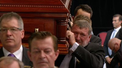 Hughes's father Greg Hughes leaving the service. (9NEWS)