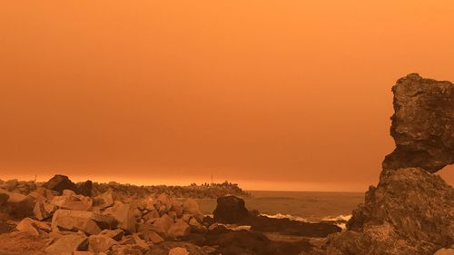 An orange hazy sky is seen over Narooma in NSW, Saturday, January 4, 2020