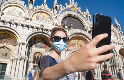 Tourist with surgical mask in Piazza San Marco, Venice, Italy