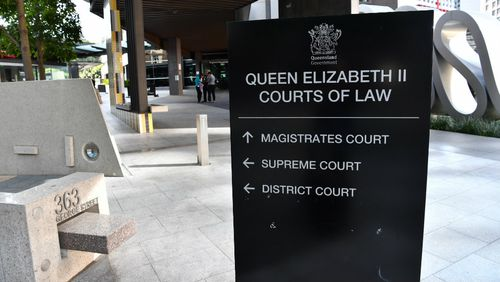 A woman almost escaped the dock at a Brisbane court today.