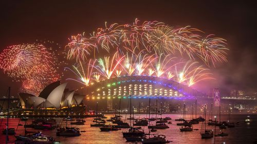 Sydney NYE 2019. The midnight New Year's Eve fireworks on Sydney Harbour, viewed from Mrs Macquarie's Chair. 1st January 2020