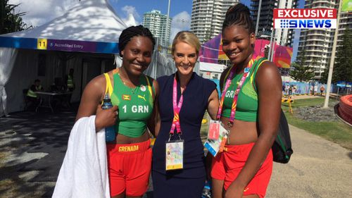 9NEWS reporter Christine Ahern with the Grenada women's beach volleyball team. (9NEWS)