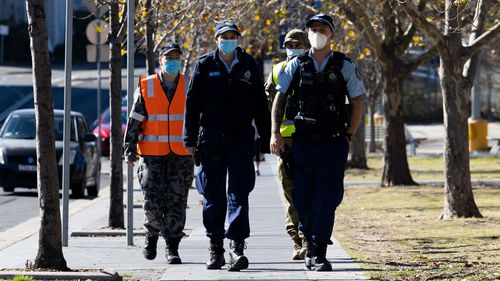 Australian Defence Force soldiers and members of the New South Wales Police Force patrol in the Bankstown CBD.