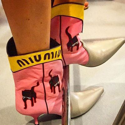 Kitties adorned boots that could have walked out of a John Wayne film and into Miuccia's workshop.