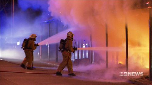 Fire fighters at the scene in September last year. (9NEWS)