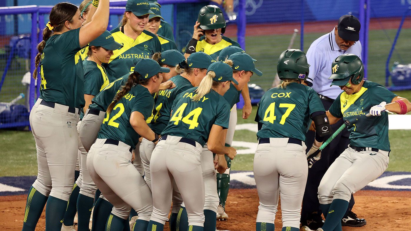 Jade Wall of Team Australia is greeted at home plate by her teammates after hitting a home run in the sixth inning against Team Mexico during softball opening round on day three of the Tokyo Olympic Games.