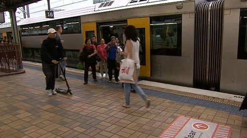 Passengers board a train at Central. (9NEWS)