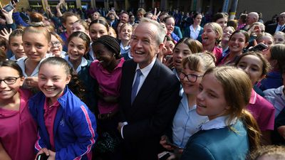 Australian Opposition Leader Bill Shorten high fives students during a visit to St. Joseph's Catholic College in East Gosford.