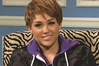 Miley looks pretty chipmunk-y as a dude - but it was all in the name of Bieber Fever as she donned a boyish mop for a skit on <i>Saturday Night Live</i>.