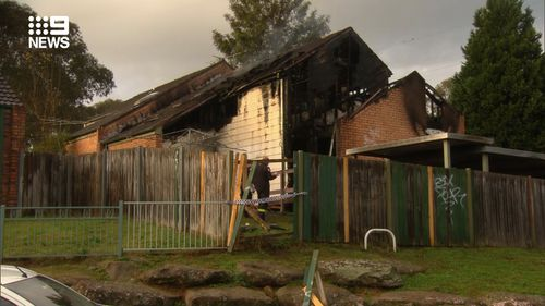 A body has been found following a suspicious house fire in Sydney's Macquarie Fields this morning.
