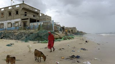 """""""The waves surprised us at night. It was October 20. The water hit hard and knocked down walls,"""" says Awa Sarr Fall, 68, outside her badly damaged oceanfront house.<br><br>""""We are calling for the help of the state and we're willing to move elsewhere."""""""