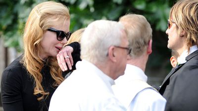 Nicole Kidman sheds a tear as  her father's coffin exits the church.