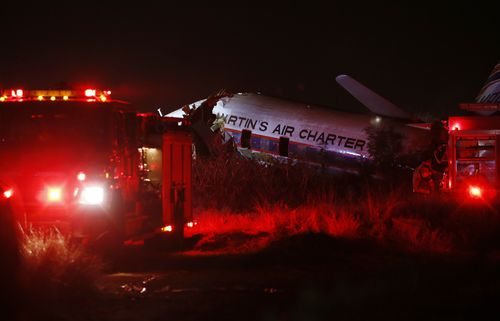 A charter plane lays in a field in Pretoria, South Africa, Tuesday July 10, 2018. The plane crashed killing one person and injuring 20 others with injuries ranging from minor to critical, according to Russel Meiring, a spokesman for paramedic company ER24. (AP Photo/Phil Magakoe)
