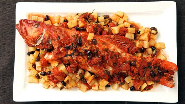 """Recipe: <a href=""""https://kitchen.nine.com.au/2016/12/13/13/09/baked-whole-coral-trout-with-potato-and-tomato"""" target=""""_top"""">Baked whole coral trout with potato and tomato</a>"""