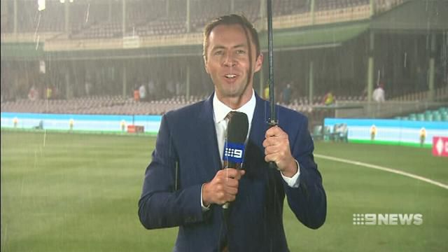 9RAW: 9NEWS reporter gets drenched at the SCG