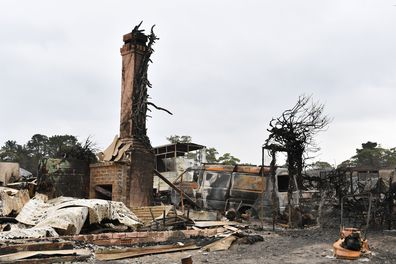 The burnt out remains of a house is seen from a bushfire in the Southern Highlands town of Wingello, 160km south west of Sydney, Monday, January 6, 2020