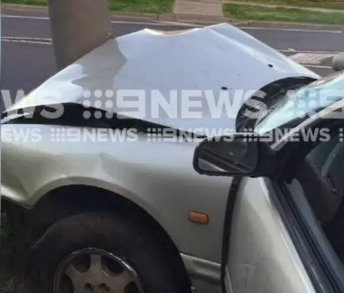 The stolen car crashed into a power pole after failing to navigate a turn.