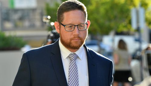 Former safety manager at Ardent Leisure Angus Hutchings leaves the inquest into the Dreamworld disaster at the Southport Courthouse on the Gold Coast, yesterday.