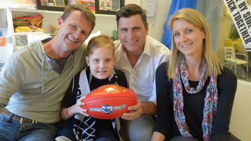 AFL players and media personalities unite to give cancer the boot