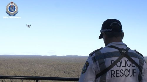A NSW Police drone pilot sends a drone into the air.