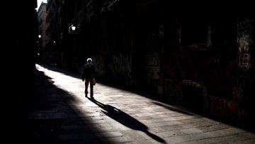 A man walks along an empty street in downtown Barcelona, Spain, Saturday, April 25, 2020 as the lockdown to combat the spread of coronavirus continues.