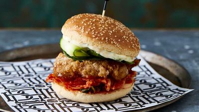 "Recipe: <a href=""http://kitchen.nine.com.au/2017/06/16/06/46/bar-lucas-gluten-free-lil-kimchi-asian-style-chicken-burger"" target=""_top"" draggable=""false"">Bar Luca's gluten free lil' kimchi chicken burger</a>"