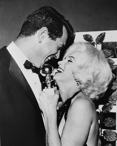 Marilyn Monroe receives her Golden Globe award from Rock Hudson at the Hollywood Foreign Press Association's 19th Annual Dinner, Beverly Hilton