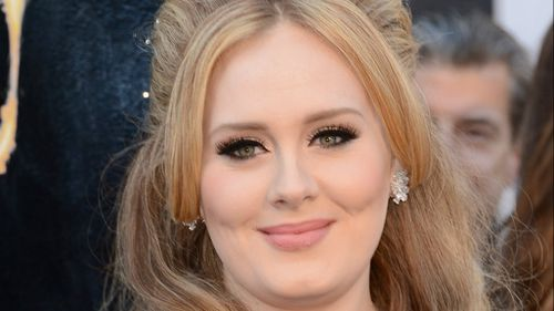 Adele's toddler son wins five-figure pay out in privacy claim over paparazzi shots