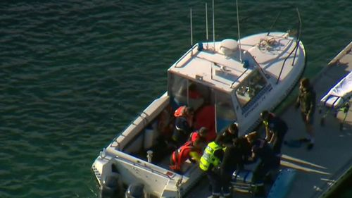 The men were brought to shore at San Remo. (9NEWS)