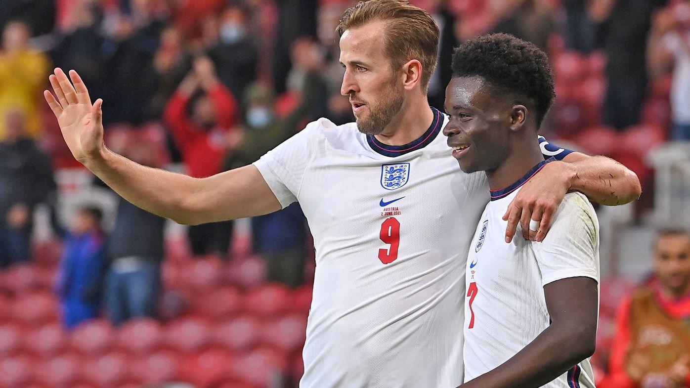 Bukayo Saka (r) of England is congratulated on scoring the opening goal by Harry Kane