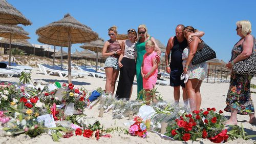 UK falls silent to mourn Tunisia resort massacre victims
